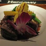 Grilled sirloin tips with pineapple chunks and orchid flower