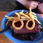 Ribs with barbecue sauce, fries and fried onions. Taste better than the look 8-)