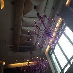 Colorful chandeliers hanging in the lobby.