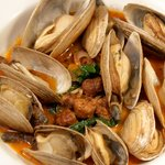 Cape Cod Steamers with Merguez, Preserved Lemons and Kale