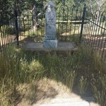 Fenced in headstone