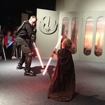 Our 3 year old son fighting a Sith Lord at the Planetarium