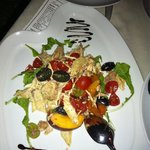 A delicious salad of their local chicken, tomatoes, rocket, grapes and nectarines, with a balsam