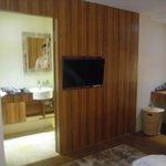 tv and door to ensuite toilet & wash room