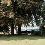 The River Hotel garden leads down to the banks of the River Thames and is shaded by horse chestn