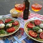 The most delicious caprese salad and wickedly good Aperol spritz!