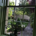 View through bedroom window, overlooking walled garden