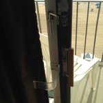 The 'custom' locking mechanism on the sliding glass door.