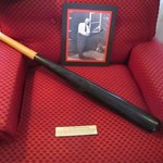 Joe Jackson's bat rests on a chair in the living room of his home.