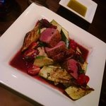 Duck with zucchini, tomatoes, and mashed potatoes.
