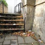 Rubbish on steps leading to river