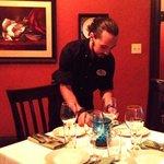 Garrett preparing a table