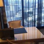 sitting area desk & floor to ceiling windows