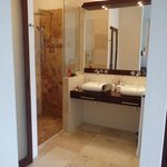 Fine marble floors and tile in shower. Master showers were even nicer.