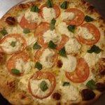 White pizza with sliced tomato basil & ricotta