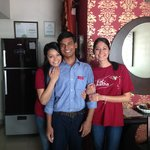 Taking a picture with the housekeeper.
