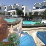 Enjoying a pint by the pool.
