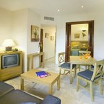 1 Bedroom Interior Apartment - kitchenette, bathroom, terrace with table & chairs (no views)