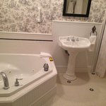 Bathroom with jacuzzi and large walk in shower