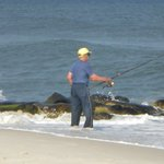 Fisherman on the uncrowded beach near Williams Cottage Inn