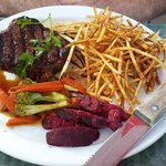 Steak, with shoestring fries and vegetables
