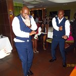 best man and groom dance for the crowd