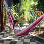 Hammock  by pool in outdoor living area