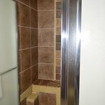 Stall shower with built in bench