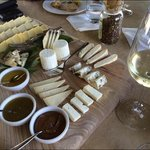 huge varietyof cheese with fresh bread and delicious wine