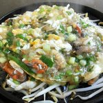 sizzling hot plate of mussels