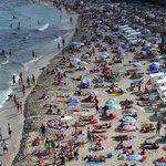 Busy beach at noon time in the summer