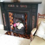 The period fireplace in the Foxglove bedroom