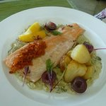 Trout with artichoke, capers and grapes