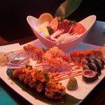 Sashimi Deluxe, Fire Island Roll w/Flame, Volacao Roll, Mango Tango Roll
