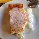 "House made cheesecake dessert with accompanying ""card motif"" sugar cubes."