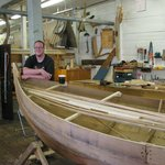 A proud student at the boat building school.
