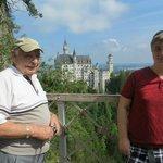 Dad and son on Mary's Bridge overlooking Neuschwanstein Castle