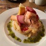 Salmon wrapped in Parma ham, with Italian mash & pesto oil