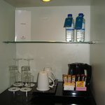 coffee/tea maker and complimentary water
