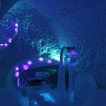 Ice hotel bed with lights in the ice