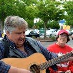A musician plays Karen a special folk tune at the Farmer's Market