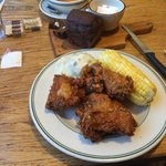 Excellent honey fried chicken dinner w corn on the cab mashed potatoes and gravy and pumpernicke