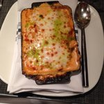 Pasta stuffed with crab, covered with lobster sauce and baked in the oven with a topping of chee
