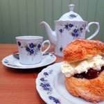 Coffe, served in some of our delightful chiina, with a scone...home made jam and cream.