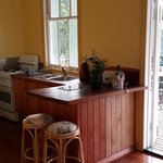 self-contained kitchen leading out to verandah. (also has a fridge)