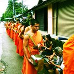 rows of monks lining up for alms