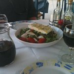 Greek salada and home made vine from the owners vineyard.  yamas