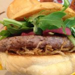 Lamb burger with crispy potato, curry mayo, red onion and greens