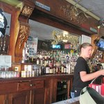 beautiful old wood bar, now  dominated by slot machines