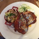 Cajun chicken with hot potato salad and cole slaw